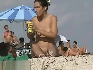 Couple split by Strangers on a nude beach