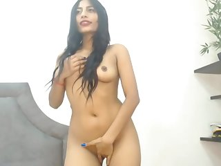 Sexy latina girl strips and sucks dildo!