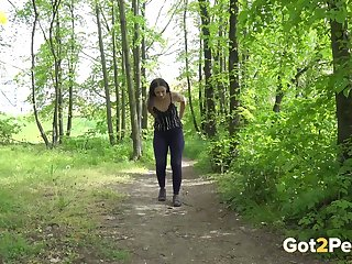 Slim temptress Nicolette Noir is an eye catching outdoor piss nut