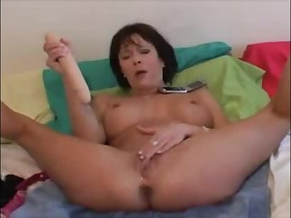 Hot milf masturbating with dildo and squirt a lot