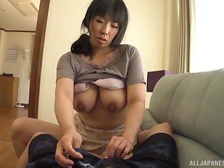 Passionate copulation on the sofa with MILF Nozomi Mikimoto