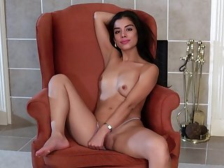Gorgeous Latina Lily Rain pleasures her pussy with a vibrator