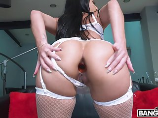 Foxy babe Analine teases with a buttplug while riding a fat dick